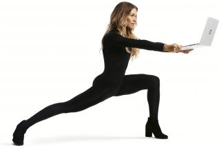Dancer Allison Holker holding the HP ENVY Notebook, stepping forward in a lunge