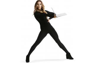 Dancer Allison Holker posing with the HP ENVY Notebook open, screen facing right