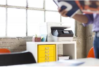HP Officejet Pro 8720 All-in-One Printer on a shelf in an office setting.