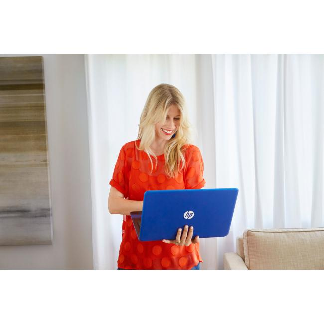 Brooke White holding her HP Pavilion Laptop at home