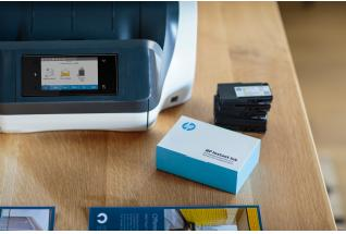 A HP OfficeJet Pro 8720 All-in-One Printer with a HP Instant Ink Welcome Kit.