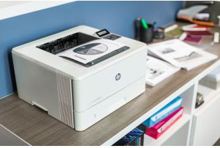HP LaserJet Pro M402dn at a office print station with Mono output